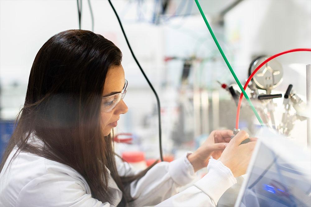 scientist working on lab equipment